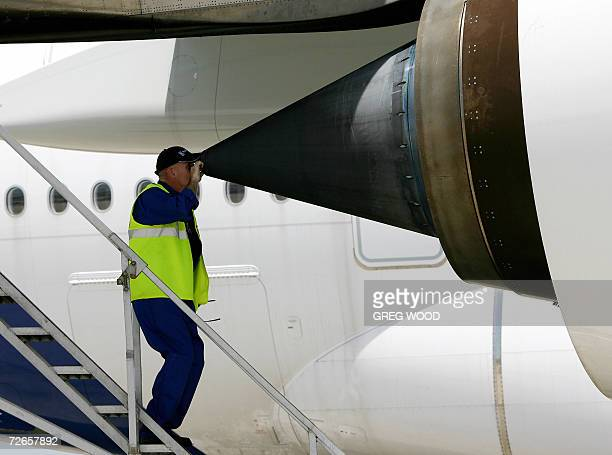 An Airbus employee checks the exhaust nozzle at the rear of the engine of an Airbus A380 superjumbo after it landed at Sydney Airport 28 November...