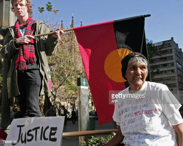 Australian Nick Pelley and Aboriginal Bowie Hickey are protesting for Mulrunji's justice at Sydney's Townhall 22 June 2007 A Queensland jury...