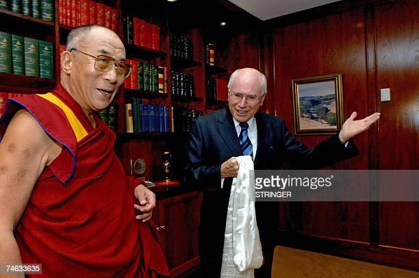Australian Prime Minister John Howard gestures as he meets with the Dalai Lama in Sydney 15 June 2007 Howard met the Dalai Lama who is in Australia...