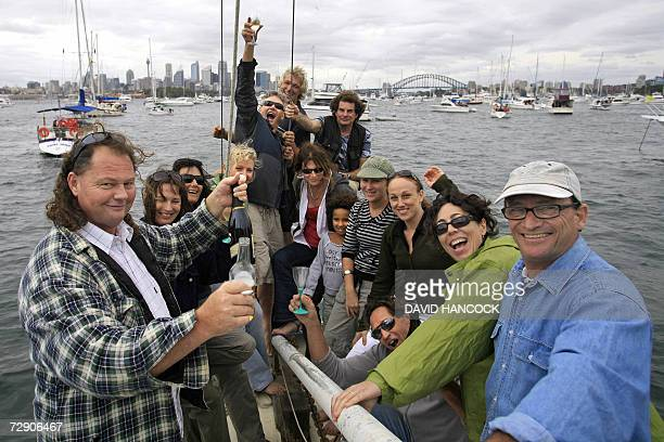 Australians offer an early cheers as they crowd into Sydney Harbour for keen vantage points for fireworks to welcome in the New Year and celebrate...