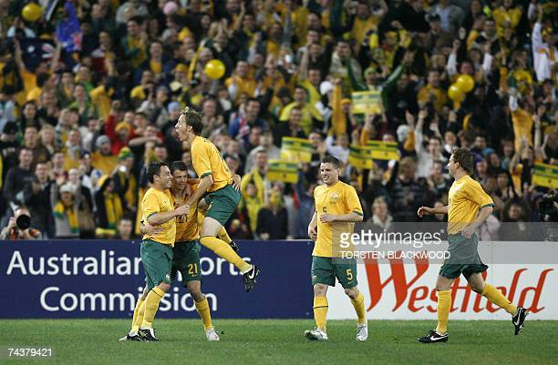 Australia's Mile Sterjovski is congratulated by teammates after scoring the opening goal against Uruguay during their football friendly at Telstra...