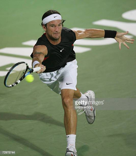 Carlos Moya of Spain plays a forehand return against Marcos Baghdatis of Cyprus in their quarter-final match at the Sydney International tennis...