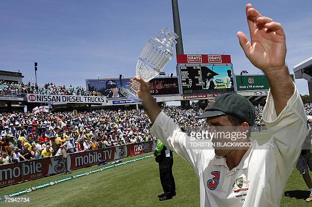 CORRECTIONADDING RESTRICTIONS MOBILE SERVICES OUT RESTRICTED TO EDITORIAL USE Retiring opening batsman for Australia Justin Langer carries The Ashes...