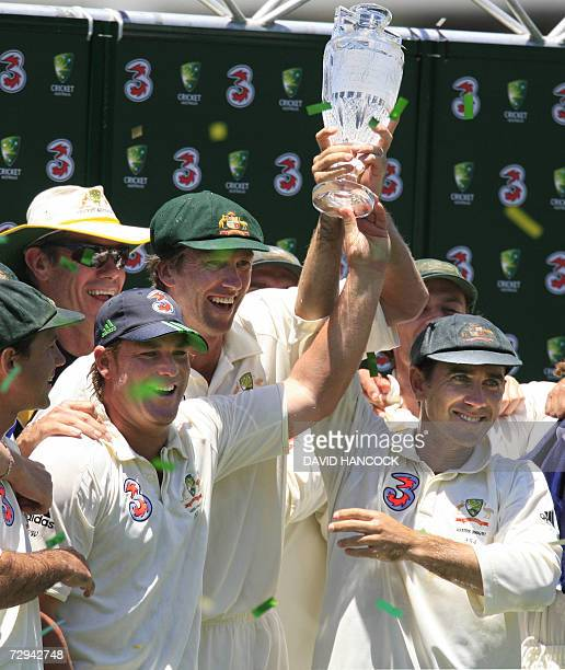 CORRECTIONMONTH IN CAPTION Retiring Australian cricketers Shane Warne Glenn McGrath and Justin Langer celebrate with the trophy after winning the...