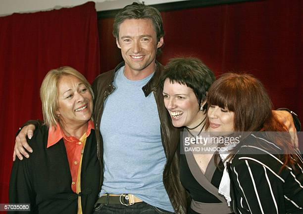 "Australian star Hugh Jackman , who plays Peter Allen in ""The Boy From OZ"", poses with Angela Toohey as Liza Minelli, Chrissy Amphlett as Judy Garland..."