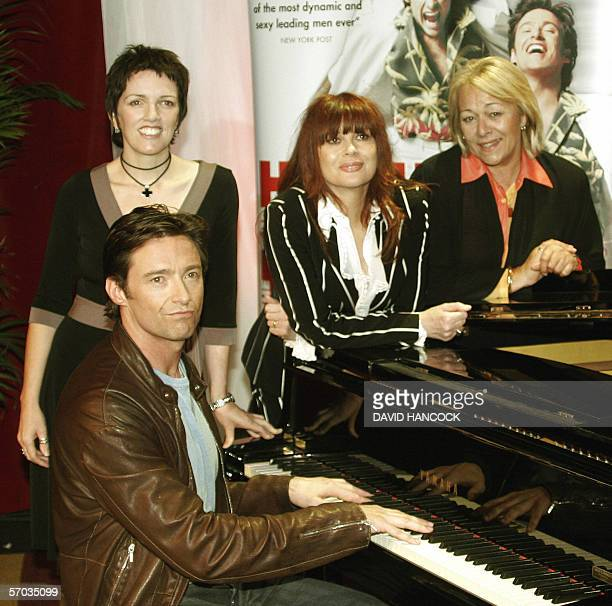 "Australian star Hugh Jackman , who plays Peter Allen in ""The Boy From OZ"", sits at the piano with co-stars Angela Toohey as Liza Minelli, Chrissy..."