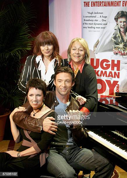 "Australian star Hugh Jackman , who plays Peter Allen in ""The Boy From OZ"", sits with Angela Toohey as Liza Minelli, Chrissy Amphlett as Judy Garland..."