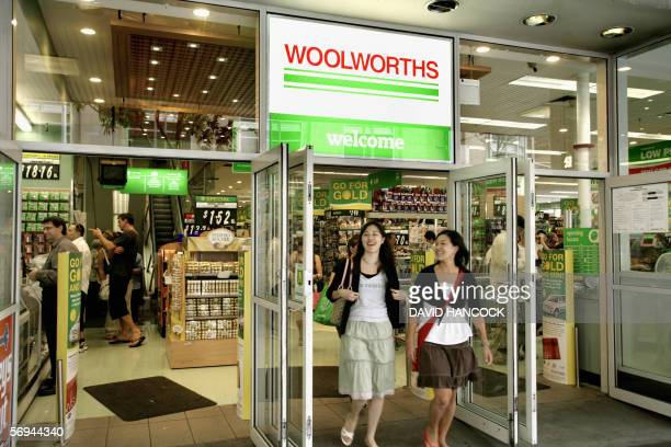 Customers exit a Woolworths outlet in Sydney 27 February 2006 Woolworths Australia's largest supermarket group reported a 22 percent lift in first...