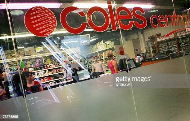 Customers go about their shopping inside a Coles supermarket in downtown Sydney 03 April 2007 Conglomerate Wesfarmers said 03 April it had led a...