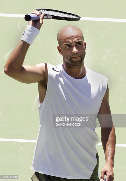 James Blake of the US celebrates after winning his men's quarter-final match against Evgeny Korolev of Russia at the Sydney International tennis...