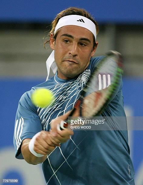 Marcos Baghdatis of Cyprus plays a backhand return against Carlos Moya of Spain in their quarter-final match at the Sydney International tennis...