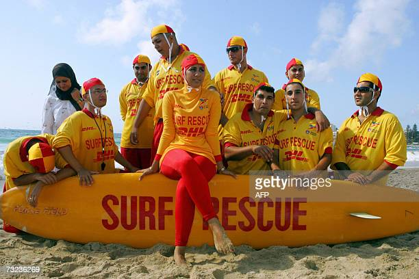 Mecca Laa Laa is wearing a full body covering known as the burqini and sits on a rescue board together with other Muslim life savers at Sydney's...