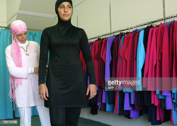 Muslim fashion designer Aheda Zanetti makes adjustments to her Islamic swimsuit worn by Australian model Mecca Laalaa at her shop in Sydney 12...