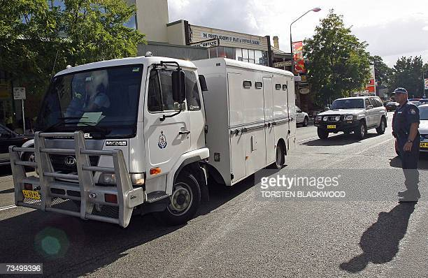 Police escort a prison van carrying nine Muslim men facing terrorism charges of planning a violent jihad in Australia from the heavily fortified...