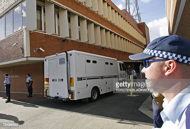 Police form a security cordon as a prison van carrying nine Muslim men facing terrorism charges of planning a violent jihad in Australia leaves the...
