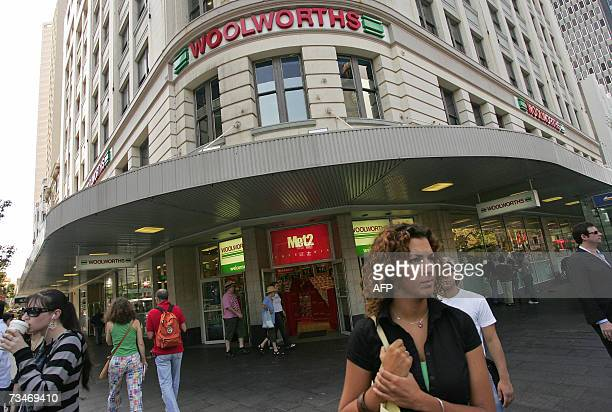 Shoppers frequent a branch of Australia's largest retailer Woolworths Ltd in Sydney 27 February 2007 Michael Luscombe the managing director and chief...