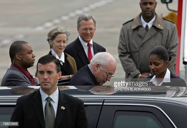 US Vice President Dick Cheney is surrounded by Secret Service agents as he arrives to board the Air Force Two Boeing 757 at Sydney International...