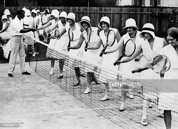 Sydney, Australia. Women from the town's middle-class learning the tennis racket feathering in a tennis school.