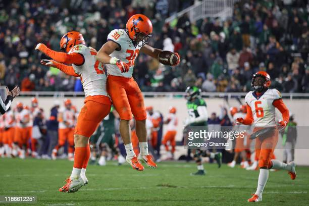 Sydney Brown of the Illinois Fighting Illini celebrates his fourth quarter interception for a touchdown with Dawson DeGroot while playing the...