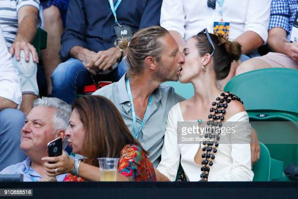 Sydney businessman Justin Hemmes kisses his partner ahead of the women's singles final between Caroline Wozniacki of Denmark and Simona Halep of...