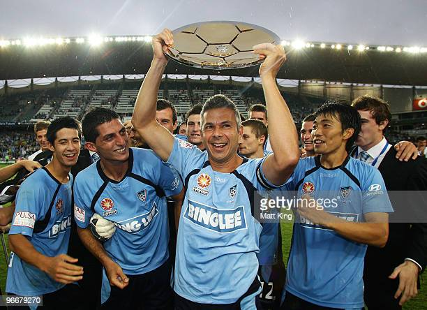 Sydney captain Steve Corica holds aloft the minor premiership trophy after the round 27 ALeague match between Sydney FC and the Melbourne Victory at...