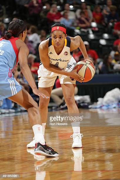 Sydney Carter of the Indiana Fever controls the ball against the Atlanta Dream during the game on May 17 2014 at Bankers Life Fieldhouse in...