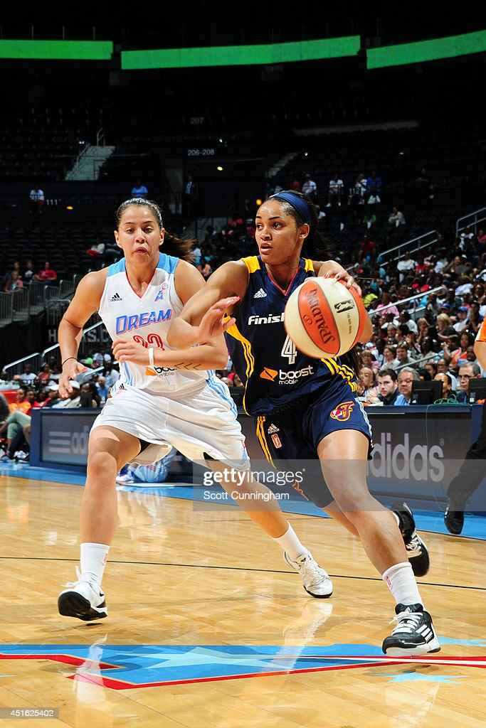Sydney Carter #4 of the Indiana Fever handles the ball against the Atlanta Dream on July 1, 2014 at Philips Arena in Atlanta, Georgia.
