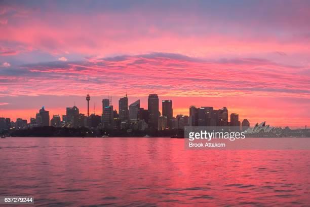Sydney CBD and The Opera House on sunset.