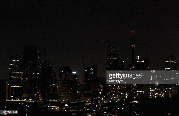 Sydney CBD is darkened during Earth Hour on March 31, in Sydney, Australia. The entire city of Sydney, including companies, government departments,...
