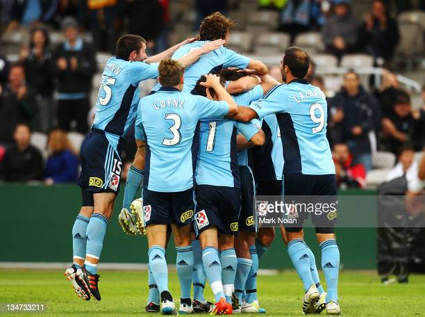 Sydney Celebrate a goal by Brett Emerton during the round nine A-League match between Sydney FC and the Brisbane Roar at WIN Jubilee Stadium on...