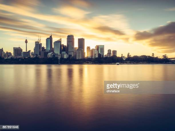 sydney city skyline against sunset sky - downtown stock pictures, royalty-free photos & images