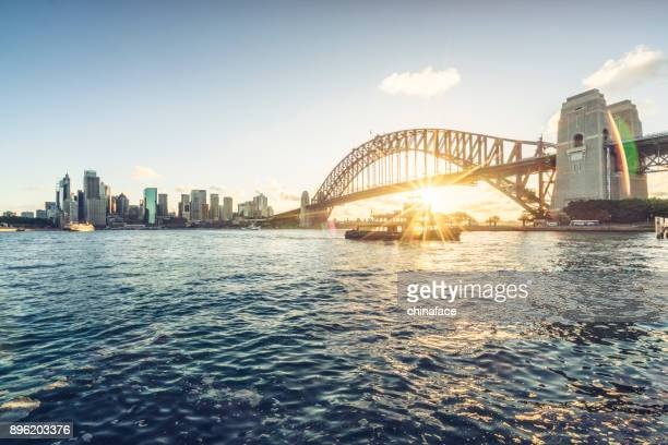sydney city skyline against sunset sky - sydney stock pictures, royalty-free photos & images
