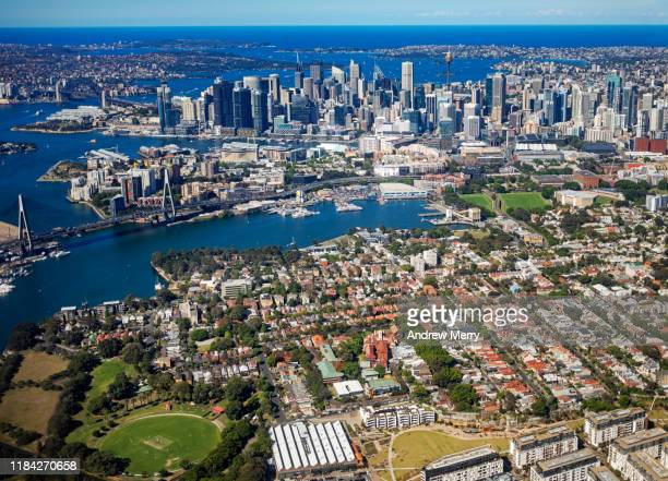 sydney city skyline with inner suburbs of glebe and pyrmont, australia, aerial photography - housing difficulties stock pictures, royalty-free photos & images