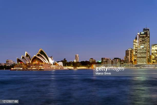 sydney cityscape at sunset. australia - marco brivio stock pictures, royalty-free photos & images