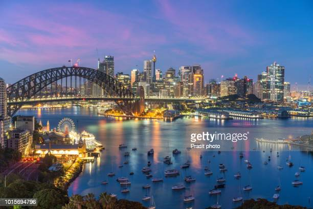 sydney. cityscape image of sydney, australia with harbour bridge and sydney skyline during sunset. - luna park sydney stock pictures, royalty-free photos & images