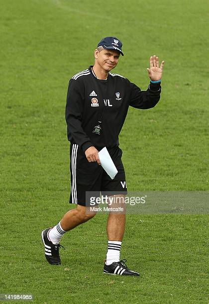 Sydney Coach Vitezslav Lavicka smiles and waves to media during a Sydney FC training session at Macquarie Uni on March 28 2012 in Sydney Australia