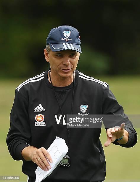 Sydney Coach Vitezslav Lavicka talks to players during a Sydney FC training session at Macquarie Uni on March 28 2012 in Sydney Australia