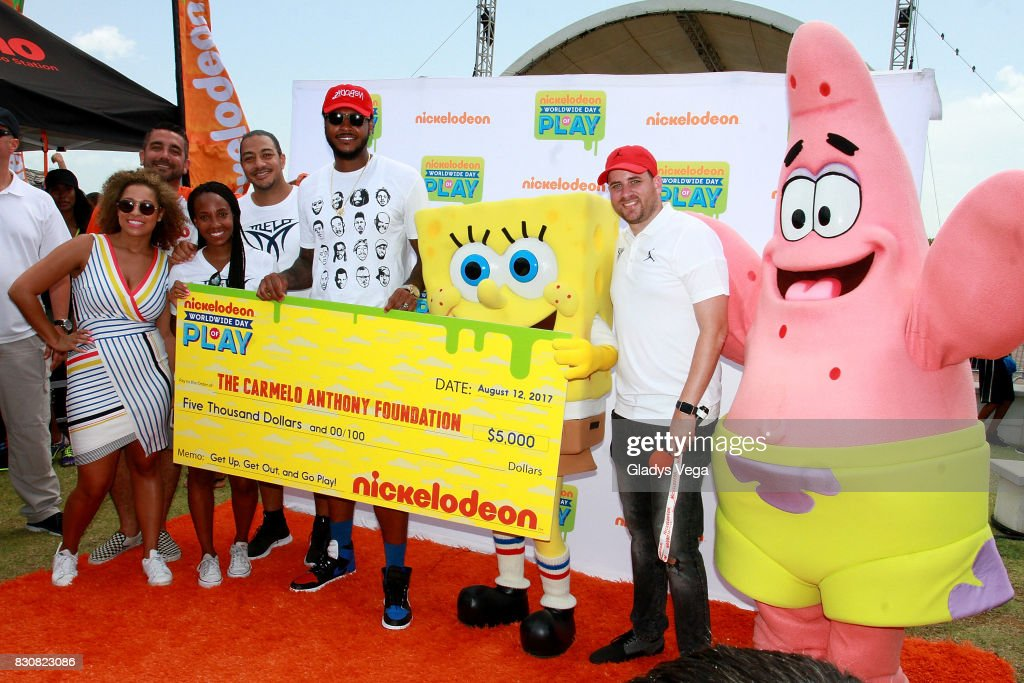 Sydney Cohn, Senior Manager of Nickelodeon Public Affairs, DJ Boogie, Asani Swann, Vice President of Brand Marketing of Carmelo Anthony Foundation, Anthony DiCosmo, Senior VP of Nickelodeon Sports Marketin, Carmelo Anthony and Danilo Beauchamp pose with the Nickelodeon characters as part of the Worldwide day of Play at Bahia Urbana Bay Side Park on August 12, 2017 in San Juan, Puerto Rico.