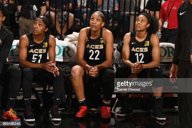 Sydney Colson of the Las Vegas Aces A'ja Wilson of the Las Vegas Aces and Nia Coffey of the Las Vegas Aces look on during the game against the China...
