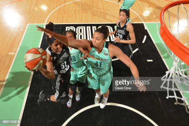 Sydney Colson of the San Antonio Stars drives to the basket against Kiah Stokes of the New York Liberty at Madison Square Garden on May 13 2017 in...