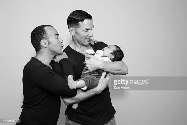 Sydney couple Faycal Dow aged 38 daughter Myla Dow aged 2 months and Hunter Dow aged 44 pose during a portrait session on May 30 2015 in Sydney...