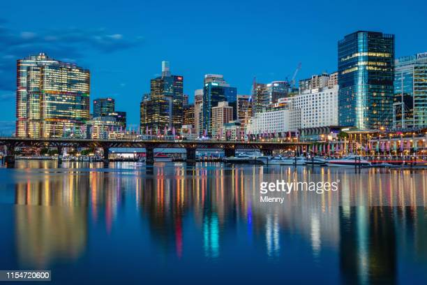 sydney darling harbor cityscape reflections at night australia - tower stock pictures, royalty-free photos & images