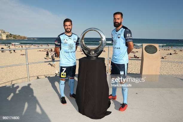 Sydney FC captain Alex Brosque and team mate Michael Zullo pose with the ALeague trophy during a Sydney FC ALeague Semi Final media opportunity at...