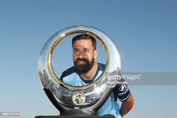 Sydney FC captain Alex Brosque poses with the ALeague trophy during a Sydney FC ALeague Semi Final media opportunity at Bondi Beach on April 23 2018...
