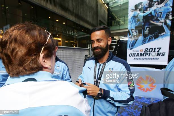 Sydney FC captain Alex Brosque signs autographs for fans in Pitt St Mall on May 8 2017 in Sydney Australia Sydney FC beat Melbourne Victory to win...