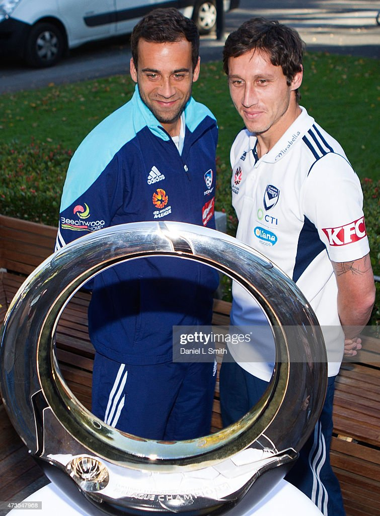 Sydney FC Captain, Alex Brosque with Melbourne Victory Captain, Mark Milligan with the A-League trphy the A-League Grand Final press conference at Federation Square on May 16, 2015 in Melbourne, Australia.