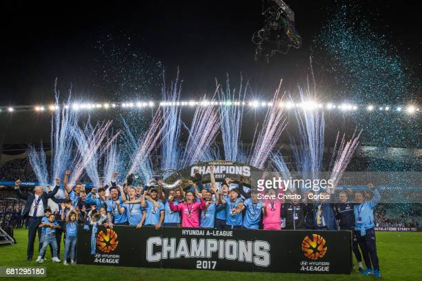 Sydney FC celebrate by holding up the ALeague Trophy beating Victory in a penalty shootout during the 2017 ALeague Grand Final match between Sydney...