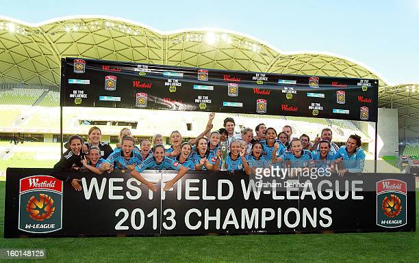 Sydney FC celebrate with the trophy after winning the WLeague Grand Final between the Melbourne Victory and Sydney FC at AAMI Park on January 27 2013...