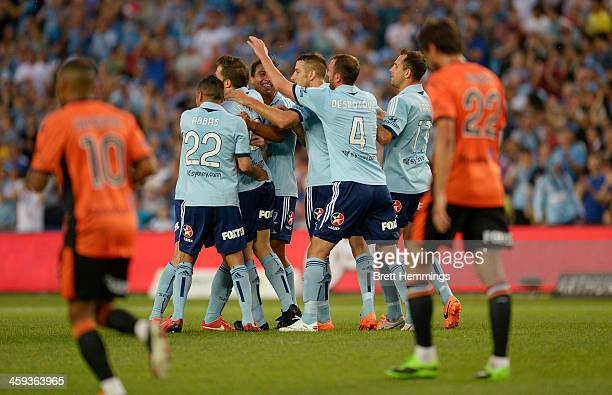 Sydney FC celebrates after scoring during the round 12 ALeague match between Sydney FC and Brisbane Roar at Allianz Stadium on December 26 2013 in...