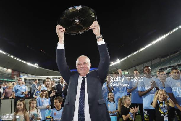 Sydney FC coach Graham Arnold celebrates with the Premiers plate after the round 27 ALeague match between Sydney FC and the Newcastle Jets at Allianz...